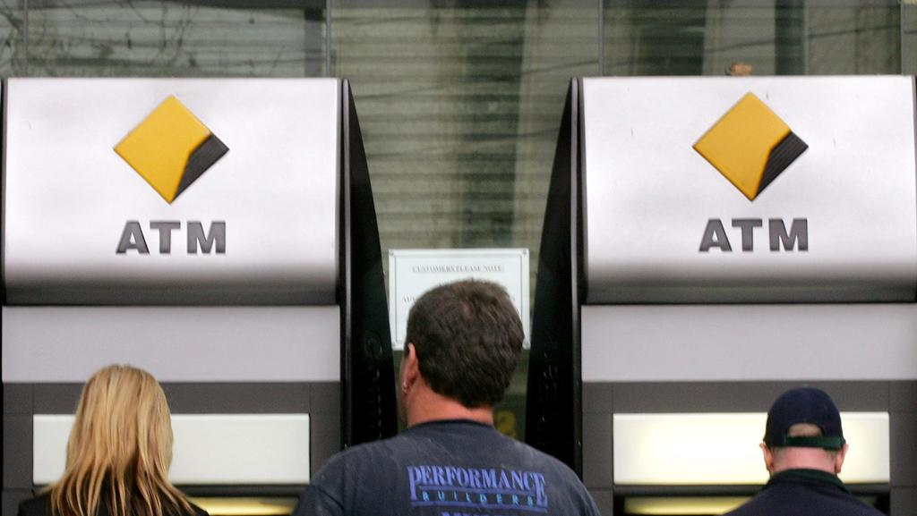 Customers use automatic teller machines (ATM) outside a branch of Commonwealth Bank of Australia. Picture: News Corp Australia