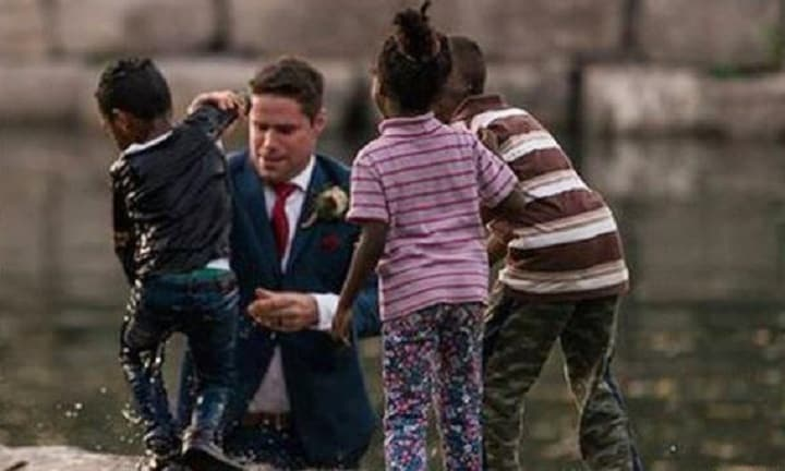 Groom interrupts wedding shoot to save drowning boy