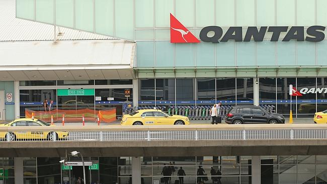 Cutting costs ... the Qantas terminal at Melbourne's Tullamarine is likely to be sold off.