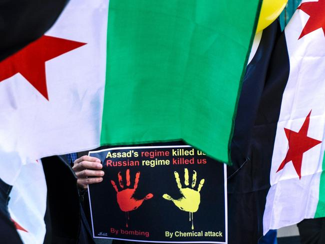A Syrian immigrant living in Bulgaria holds a placard last week in front of Syrian embassy in Sofia, during a protest against chemical attack in the Syrian province of Idlib. Picture: Dimitar Dilkoff/AFP