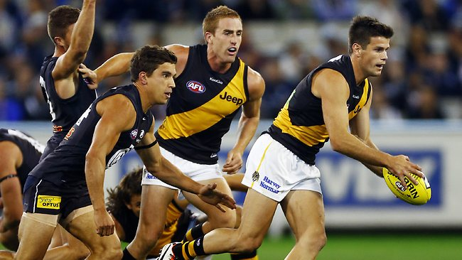 Trent Cotchin clears out of the middle. Picture: Michael Klein