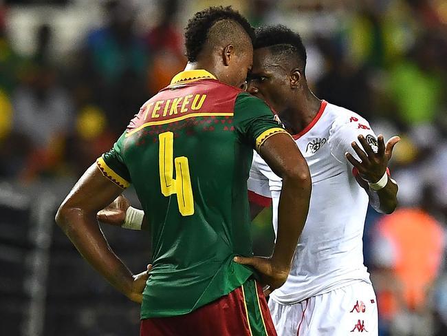 Cameroon's defender Adolphe Teikeu (L) argues with Burkina Faso's forward Banou Diawara