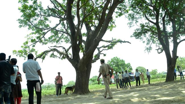 Execution site ... police at the tree where two teenage girls were found hanging after they were gang raped in the northern Indian state of Uttar Pradesh.