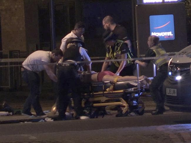 A victim from the Borough Market is taken away on a stretcher. Picture: AP