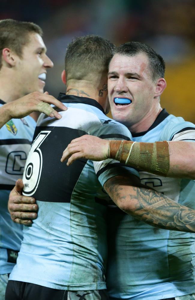 Paul Gallen and Todd Carney celebrate a win against the Broncos.