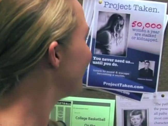 The Sherri lookalike passes a Project TAKEN poster in the video warning 'you never need us until you do'.
