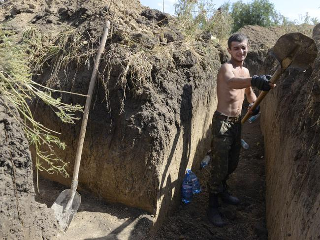 An Ukrainian soldier digs a trench on the outskirts of the southern Ukrainian city of Mariupol. Picture: Alexander Khudotepky
