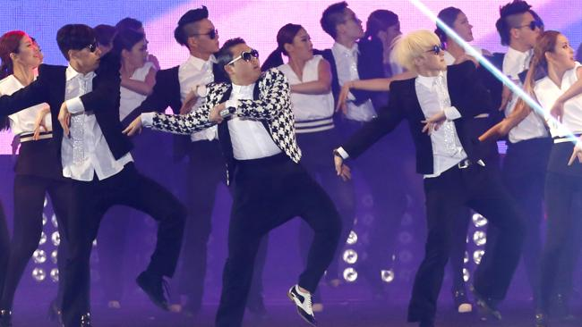 """South Korean rapper PSY, in a checkered jacket, performs his new song """"Gentleman"""" in his concert titled """"Happening"""" in Seoul, South Korea Saturday, April 13, 2013. PSY's first new single since his megahit """"Gangnam Style"""" was released in 119 countries on Friday, his agency said. (AP Photo/Kin Cheung) Picture: Ap"""