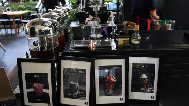 Drinks called 'death' and 'painful' are available to order at the cafe. Picture: AFP/Lillian Suwanrumpha