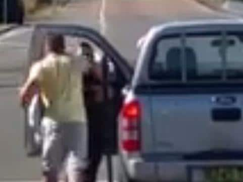 Violent Road Rage Attack on a Woman. Video grab from Facebook. A man got out of his car and punched a female driver in the face during a violent road rage attack at Doyalson on the NSW Central Coast. Posted by Dwayne Pillidge on the Dash Cam Owners Australia Facebook page.