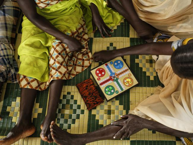 South Sudanese refugee women who suffered sexual or other gender-based violence play a board game at a women's centre run by the aid group International Rescue Committee, in Bidi Bidi, Uganda. Picture: Ben Curtis/AP