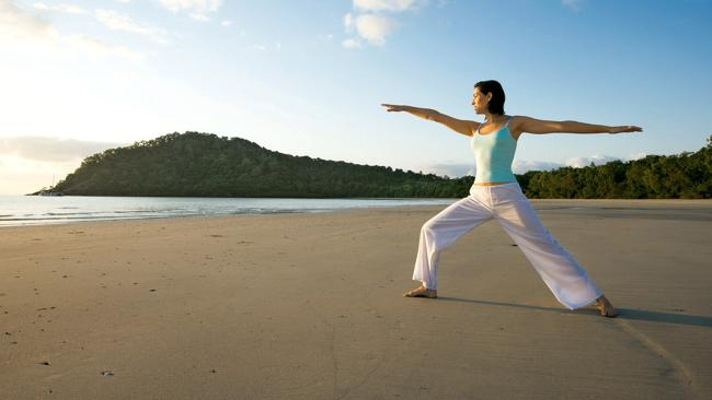 Yoga at sunrise on Myall Beach at Cape Tribulation Camping. Picture: Supplied