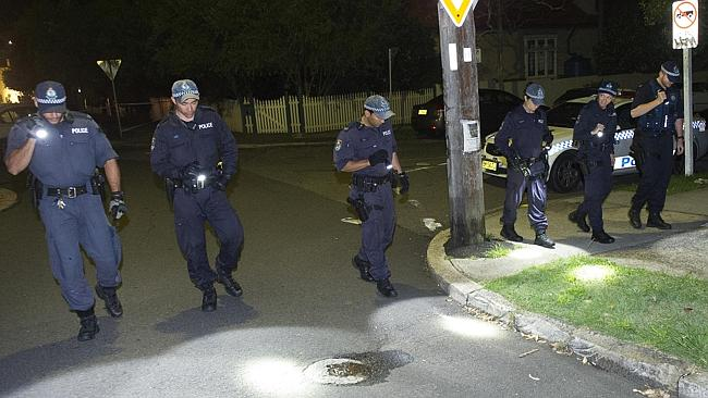Police conduct a line search for clues to the fatal shooting of a man at Petersham. Picture: Chris McKeen