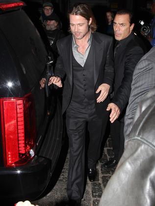Brad Pitt gets mobbed.