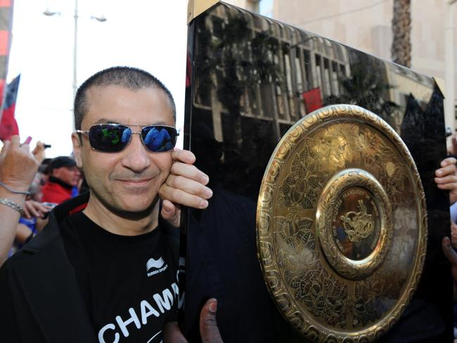Mourad Boudjellal carries the Top 14 trophy during a celebration on the streets of Toulon.