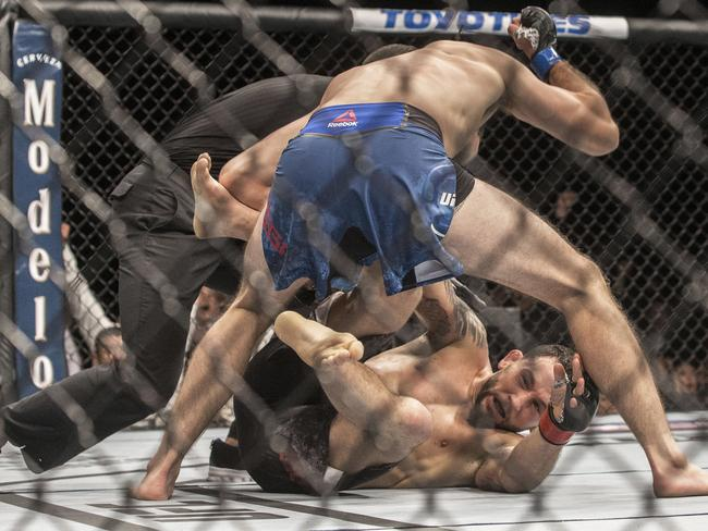 Brian Ortega finishes off Frankie Edgar with a series of punches. (Benjamin Hager/Las Vegas Review-Journal via AP)
