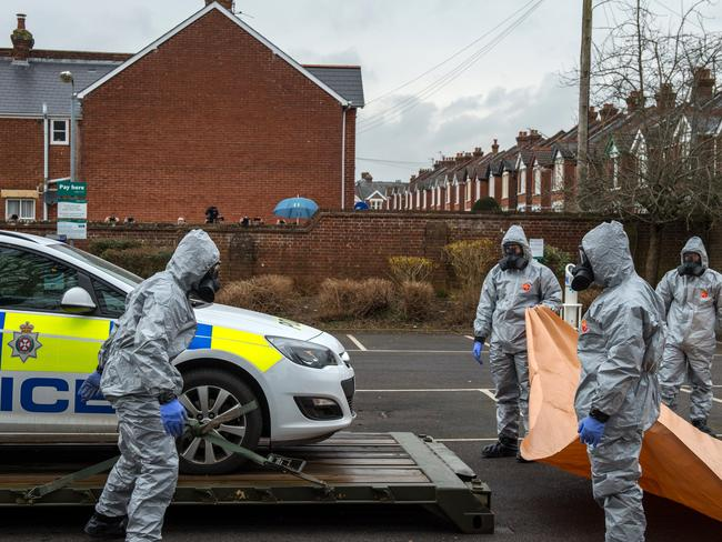 Military personnel wearing protective suits continue investigations into the poisoning of Sergei Skripal in Salisbury, England with a nerve agent. Picture: Getty Images