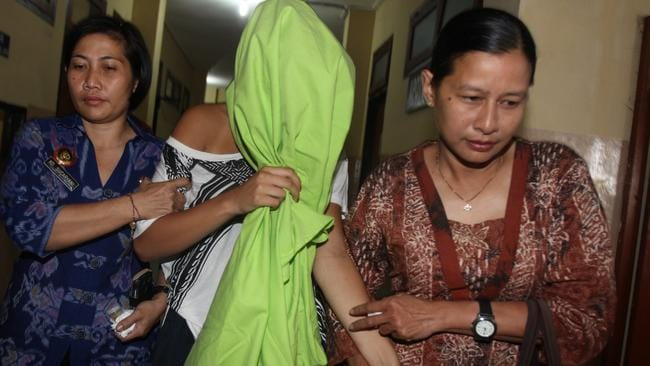 Heather Mack is escorted to the police hospital in Bali for tests. Picture: News Corp