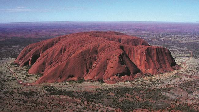 Uluru, in Central Australia, from the air. Every notch and crevice around the perimeter of the rock is used as a location by Indigenous Australians to memorise information. Picture: Ian Rowland