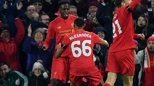 Divock Origi of Liverpool (L) celebrates with team mate Trent Alexander-Arnold after scoring their first goal against Leeds in the EFL Cup Quarter-Final.
