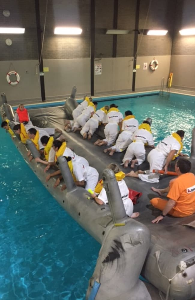 The recruits must paddle away from any floating debris.