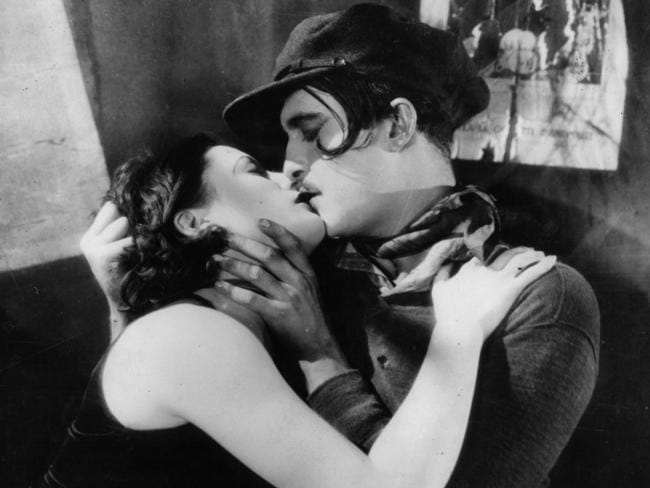 Greta Garbo kissing an unidentified man in the 1929 film The Kiss.