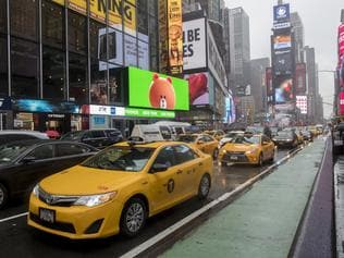 FILE - In this Thursday, May 25, 2017, file photo, traffic makes its way down Seventh Avenue in New York's Times Square. Cruise Automation, a self-driving software company owned by General Motors, will start testing in New York in early 2018. They'll have an engineer behind the wheel to monitor performance. Cruise CEO Kyle Vogt says the densely populated city will give the company more unusual situations to test software. Cruise currently is testing in San Francisco. (AP Photo/Mary Altaffer, File)