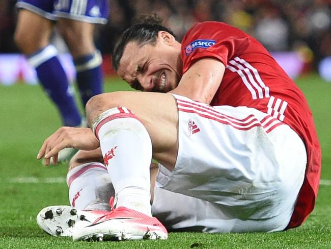 Manchester United's Swedish striker Zlatan Ibrahimovic reacts after falling awkwardly.