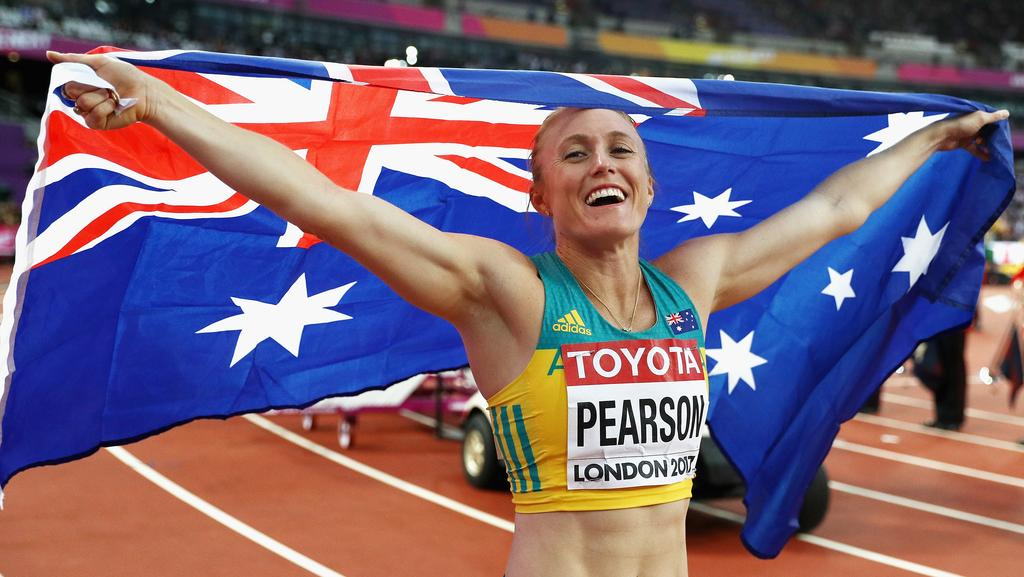 Sally Pearson celebrates winning gold in the Women's 100 metres hurdles final during day nine of the 16th IAAF World Athletics Championships.
