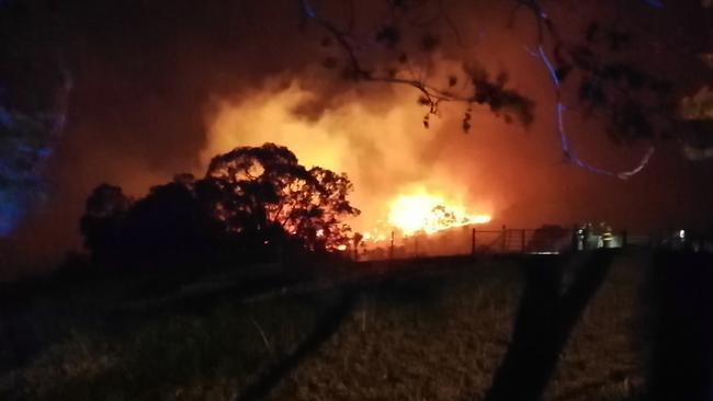 The fire comes perilously close to Malcolm Roberts' Paracombe property. Picture: Paul Reidel
