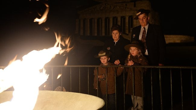 David and Sue Doughty from Boronia and their grandchildren Riley, 3, and Isabella, 8, around the eternal flame at the Shine of Remembrance. Picture: Nicole Garmston