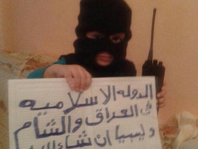 Young jihadi: A child is pictured on an ISIS-supporting Twitter feed wearing a balaclava and holding a sign saying 'God is greatest'.