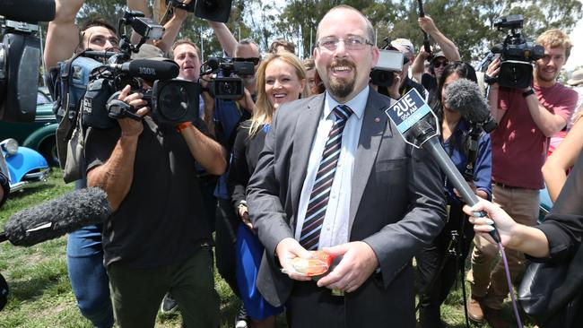 No comment ... Senator Ricky Muir leads the media on doughnuts around a car show. Picture: Ray Strange/News Corp