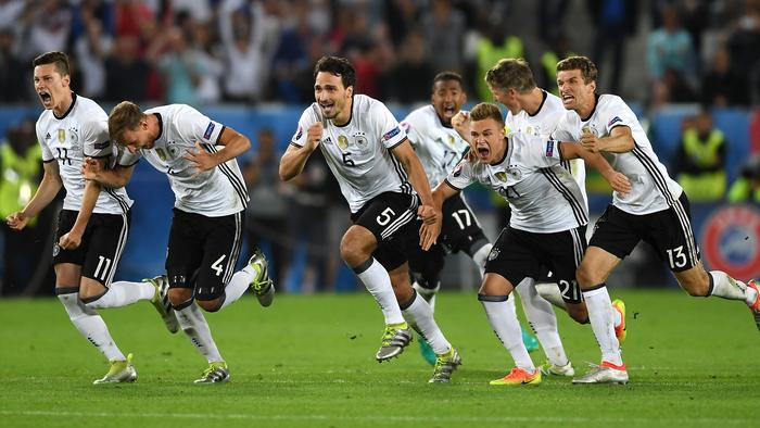 Germany players dash to celebrate their win.