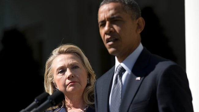 Secretary of State Hillary Rodham Clinton listens as President Barack Obama speaks on the death of US ambassador to Libya Christopher Stevens. Picture: AP