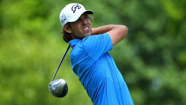 Aaron Baddeley watches his tee shot on the 18th hole during the second round of the Memorial Tournament.