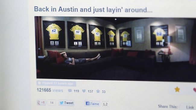 THUMBING his nose . . . a picture posted by Lance Armstrong showing him with his framed Tour de France winner's jerseys in his Austin home.