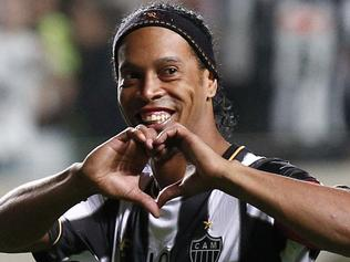 Brazil's Atletico Mineiro's Ronaldinho celebrates his team's victory over Argentina's Newell's Old Boys at the end of a Copa Libertadores semifinal soccer match in Belo Horizonte, Brazil, early Thursday, July 11, 2013. Atletico Mineiro qualified for the Copa Libertadores final against Paraguay's Olimpia. (AP Photo/Bruno Magalhaes)