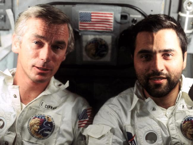 "Astronaut Eugene A. Cernan (left) and astronaut-geologist Harrison H. ""Jack"" Schmitt, photographed by the third crew member Ronald Evans, aboard the Apollo 17 spacecraft."