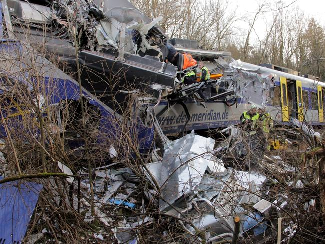 Rubble ... at leats 150 people are injured after the deadly collision. Picture: Josef Reissner/dpa via AP