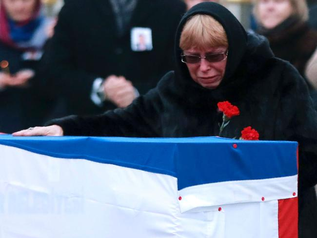Marina Davydova Karlova, widow of late Russian Ambassador to Turkey Andrey Karlov, grieves over his coffin. Picture: AFP/Adem Altan