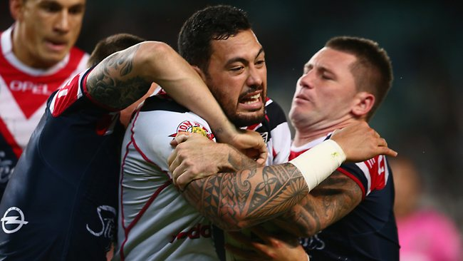 Feleti Mateo is wrapped up by the Roosters defence.