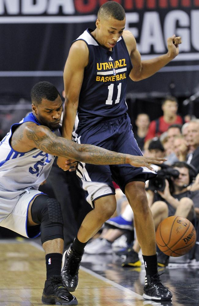 Philadelphia 76ers' Sean Kilpatrick attempts to grab a loose ball against Utah Jazz's Dante Exum.