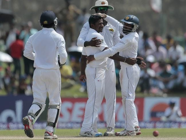 Rangana Herath is congratulated by teammates after removing Pakistani batsman Asad Shafiq.