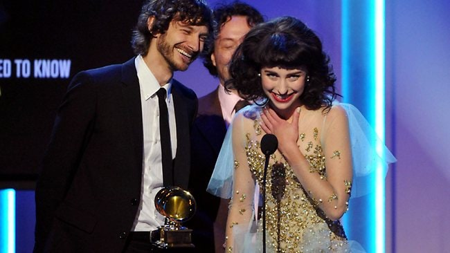 "Gotye, left, and Kimbra accept the award for best pop duo/group performance for ""Somebody That I Used to Know""."