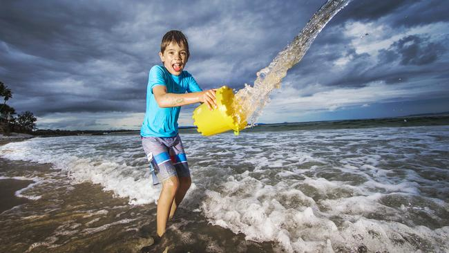 Felix Laios, 8, from Melbourne, wasn't turned off by the storm clouds over Noosa. Picture: Nigel Hallett