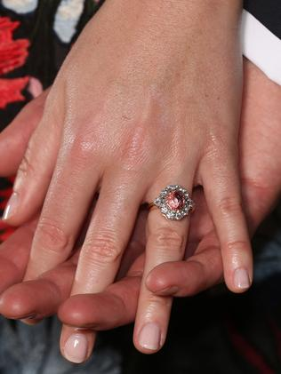 Princess Eugenie shows off her engagement ring. Picture: AFP/Jonathan Brady