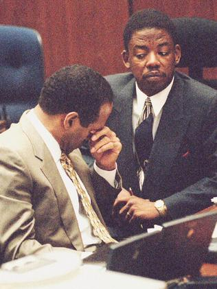 Gruelling trial ... OJ Simpson and one of his lawyers during the double murder trial.