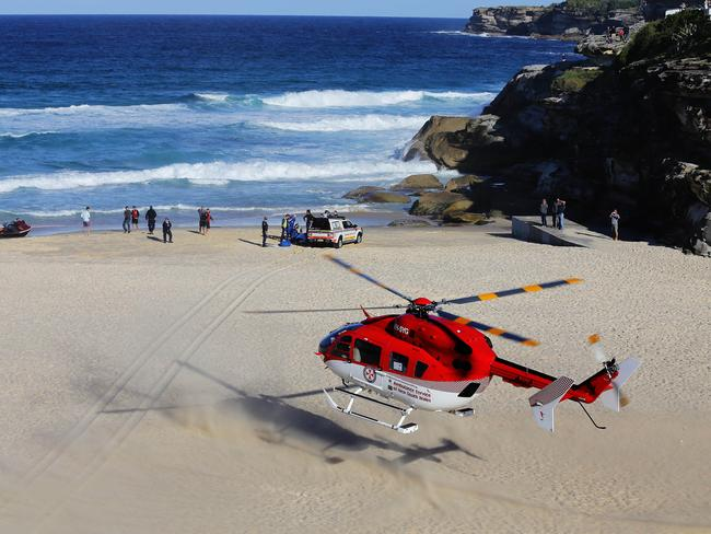 Paramedics try to save Richell at Tamarama beach on Wednesday. Picture: Brett Costello