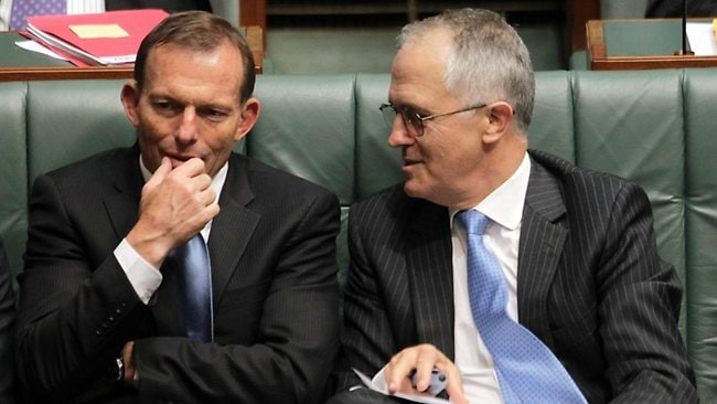 Malcolm Turnbull talks with Tony Abbott during Question Time